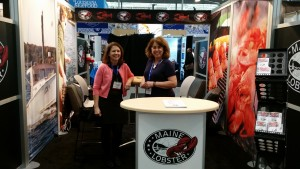MLMC marketing director Marianne LaCroix, left, and office manager Kara Morrison, right, cheerfully greeting visitors to the MLMC booth. Photo by P. McCarron.
