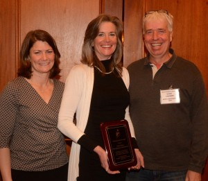 From left to right, Patrice McCarron, MLA executive director, Outstanding Service award recipient Sarah Cotnoir, and MLA president David Cousens. Photo courtesy of Mike Young and Mark Haskell Photography.