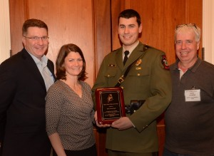 From left to right, DMR Commissioner Patrick Keliher, Patrice McCarron, Officer of the Year award recipient Owen Reed, and David Cousens. Photo courtesy of Mike Young and Mark Haskell Photography.