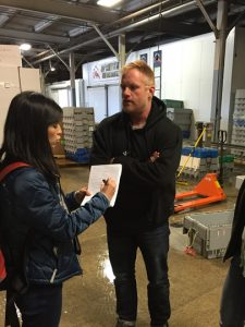 Ylan Mui, Washington Post reporter, meeting with John Leavitt, Ready Brothers Seafood, at the company's Portland facility. MLMC photo.